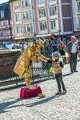 Pantomime In Golden Ancient Dress Greets A Boy