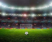 foto of grass area  - Soccer ball on the field of stadium with light - JPG