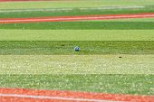 pic of infield  - A baseball on an infield of a baseball field - JPG