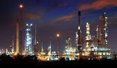 Beautiful Landscape Dusky Sky Of Heavy Industry Oil Refinery Plant With Dazzled Lighting