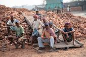 SARBERIA,INDIA, JANUARY 16: Brick field workers rest after hard work, wearing just baked brick from