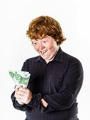Happy Red-haired Boy With Money