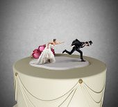 picture of runaway  - Funny Escape from marriage concept over a cake - JPG