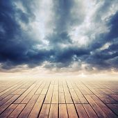 Wooden Floor With Perspective And Stormy Cloudy Sky, Toned Effect