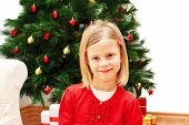 Portrait Of Little Cute Girl With Christmas Present