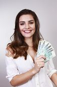 brunette woman with money brazilian