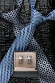 Two Necktie And  Cufflinks  Lying On The Skin
