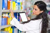 Pharmacist working with a tablet in the pharmacy