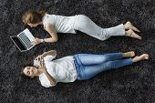 Young Women Relaxing On The Carpet