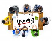 Multiethnic Group of People Discussing About Learning