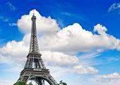 Eiffel Tower Against Cloudy Blue Sky
