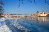 Snowy Prague With Frozen River Vltava