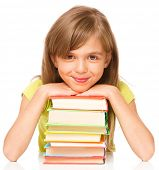 Portrait of a little girl with her books, isolated over white