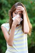 Young girl with allergy outdoors