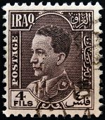 IRAQ - CIRCA 1934: A stamp printed in Iraq shows Ghazi bin Faisal