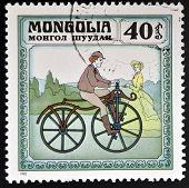 MONGOLIA - CIRCA 1982: stamp printed in Mongolia shows retro bike circa 1982