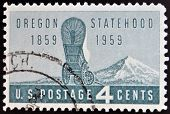 UNITED STATES OF AMERICA - CIRCA 1959: A Stamp printed in USA shows the covered Wagon