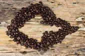 Arrow Coffee Beans On The Wooden Floor
