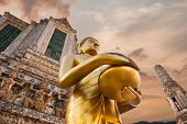 Big Statue Of Golden Buddha In Wat Arun Or Temple Of Dawn. Thai Traditional Buddhist Architecture