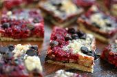 stock photo of shortbread  - A sweet dessert square made from dark chocolate and raspberries with a shortbread crust - JPG