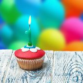 Cupcake With Number One On The Background Of Balloons