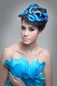elegant fashion brunette Thai woman posing with creative chignon hair-style