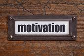 motivation  - file cabinet label, bronze holder against grunge and scratched wood