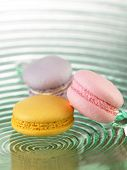 Colorful macaroon on the glass plate