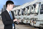 Business Man Using Tablet To Handle Export And Import Container Transport