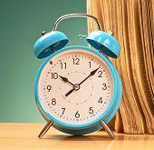 Blue alarm clock composition