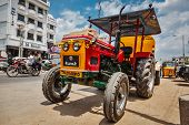 KANCHIPURAM, INDIA - SEPTEMBER 12, 2009: Wheeled tractor in indian street