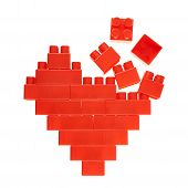 Heart symbol made of toy bricks