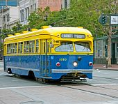 image of railcar  - Blue and Yellow Electric Streetcar on Market Street in San Francisco - JPG