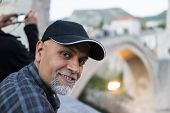 picture of pakistani  - Senior Arabic Pakistani man traveling to Mostar in Bosnia - JPG