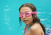 Beautiful little girl at the pool