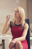 beautiful young woman with cigarette