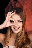 Young woman shows OK sign