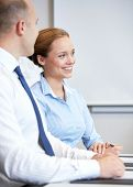 business, people and teamwork concept - smiling businessman and businesswoman meeting in office