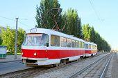 Red tramway at city street