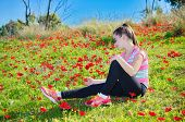 Teenage Girl With Braces In A Field Of Wild Red Flowers