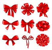 Big collection of red gift bows with ribbons.