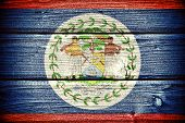 picture of conquistadors  - flag of Belize painted on old grungy wooden background - JPG