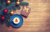 Cappuccino And Gift With Pine Branch On Wooden Table.