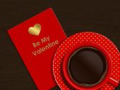 Coffee With Valentine Card Over Wooden Background