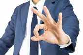 Businessman With Ok Sign Hand Gesture Isolated On White Background