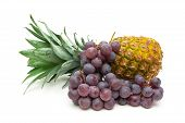 Bunch Of Dark Grapes And Pineapple Isolated On White Background Close-up
