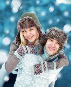 Happy Young Couple Having Fun Playing Outdoors In Winter Day