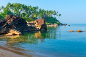 Green Palm Trees And Turquoise Sea In A Beautiful Location Goa