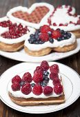 Waffle Cookies In The Form Of Hearts Decorated With Whipped Cream And Berries.