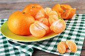 Tangerines in plate on table